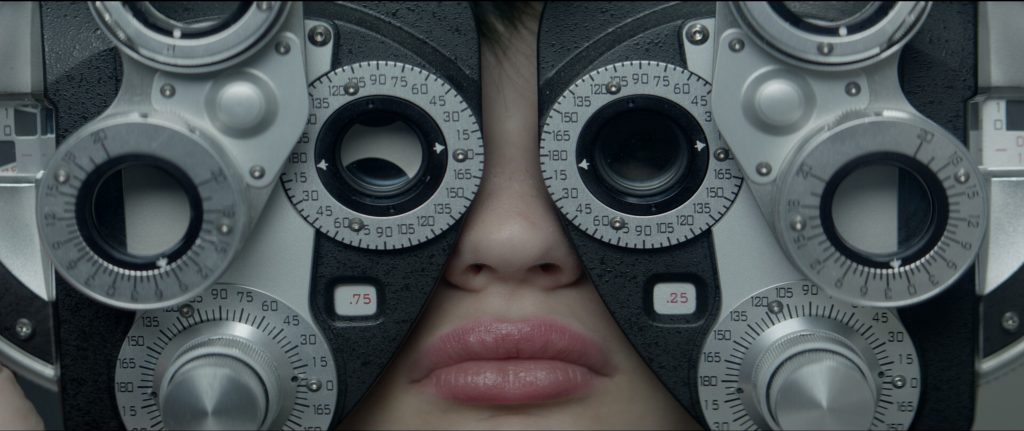 The race against time starts after this visit to the optometrist. Photo still from movie.