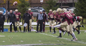 Keegan Treloar performs a kick-off during the Shrinebowl game in 2014 against the McGill Redman. Photo by Andrej Ivanov.