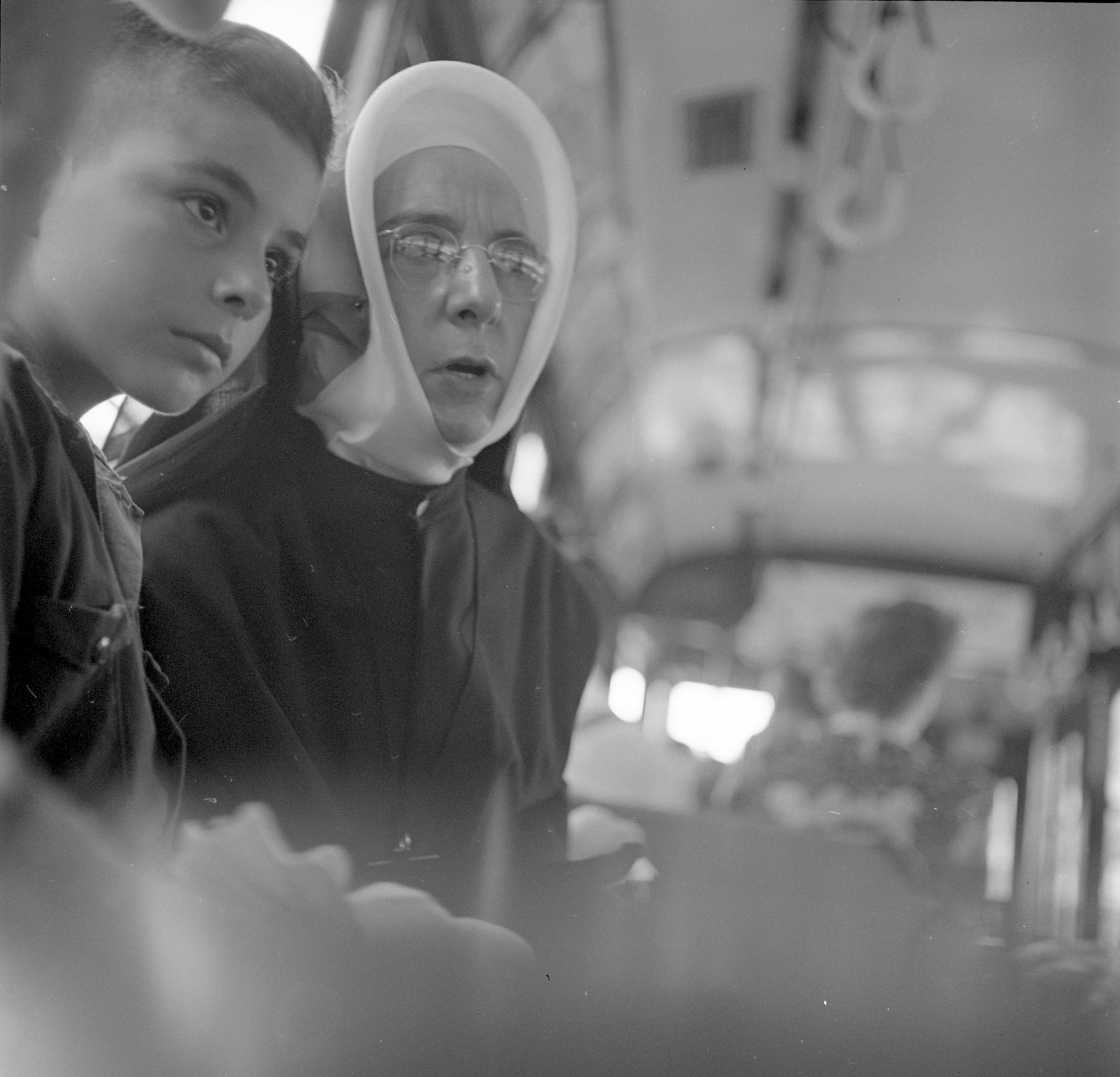 A boy and a nun take a bus in Montreal.
