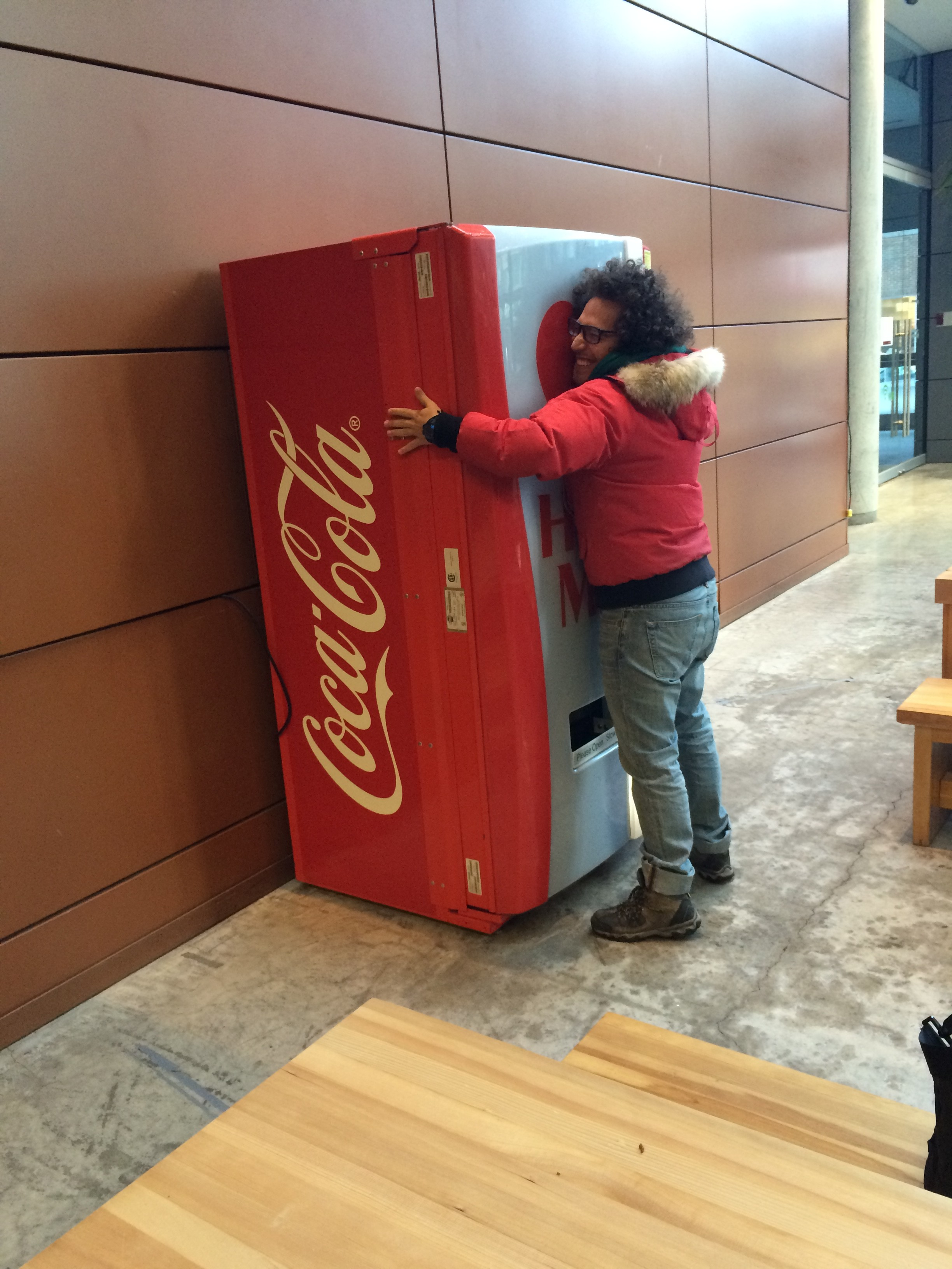 Nikolas Romero partakes in Coca-Cola's Wednesday marketing campaign because he likes how it encourages hugs. Pictures by Michelle Gamage.