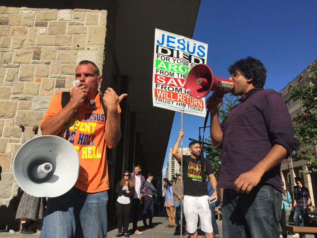 Activist Jaggi Singh (photographed on the right) describes he was protesting against to bigotry of this preachers speech, however not against Christians. Photo by Savanna Craig.