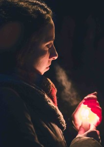 A participant sheds a tear during the vigil. Photo by Keith Race.