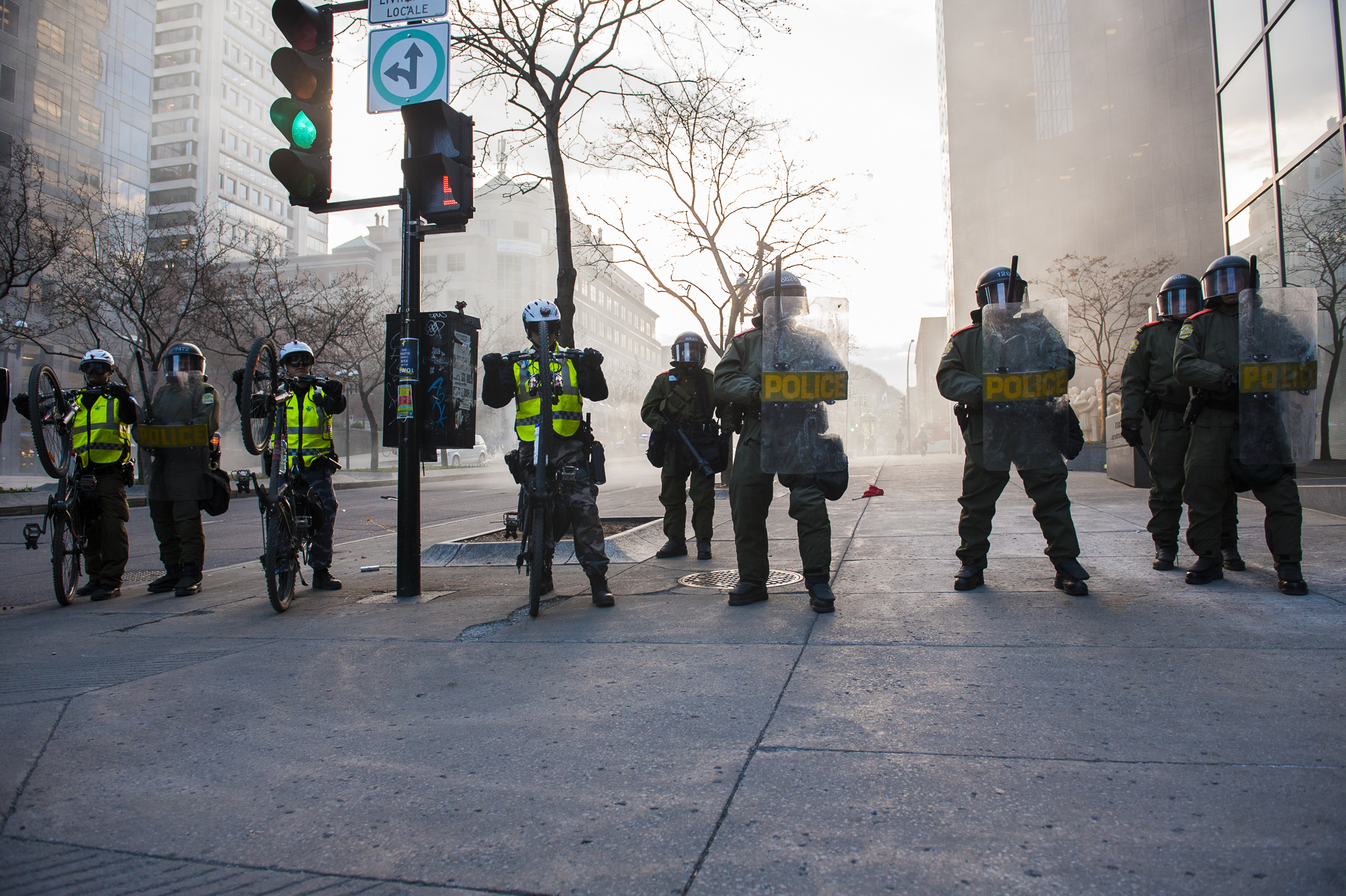 Riot police block McGill College after a clash with marchers after a protester lit a flare. - A.I.