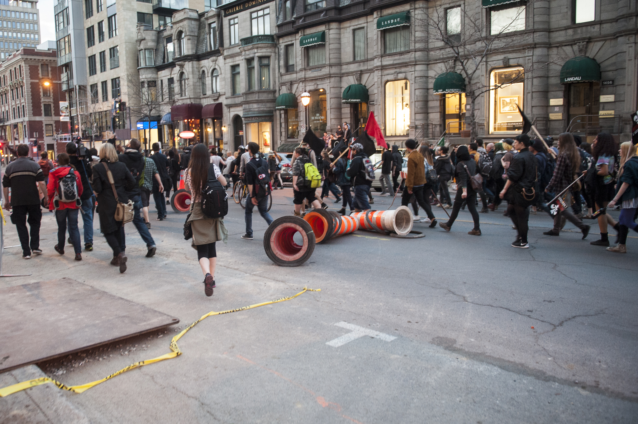 Cones left on Sherbrooke St. to disrupt traffic after protesters passed.- A.I.