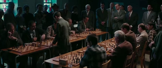 Bobby Fischer in the midst of taking down multiple opponents. Photo still from Pawn Sacrifice.