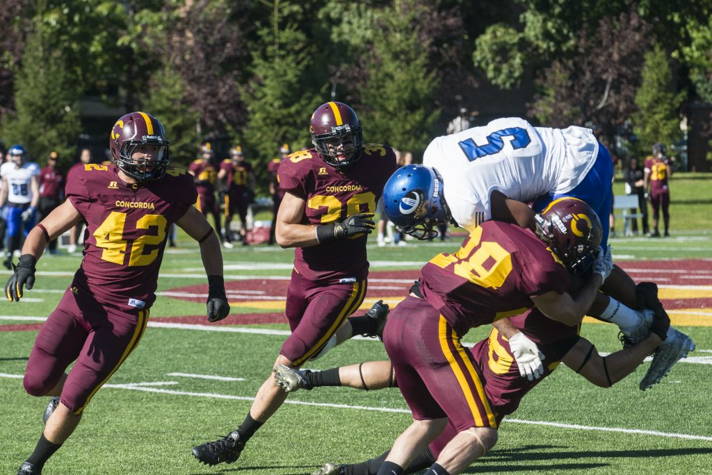 Stingers defenders lay out Université de Montréal ball carrier Saturday afternoon at Concordia's homecoming game. Photos by Andrej Ivanov.