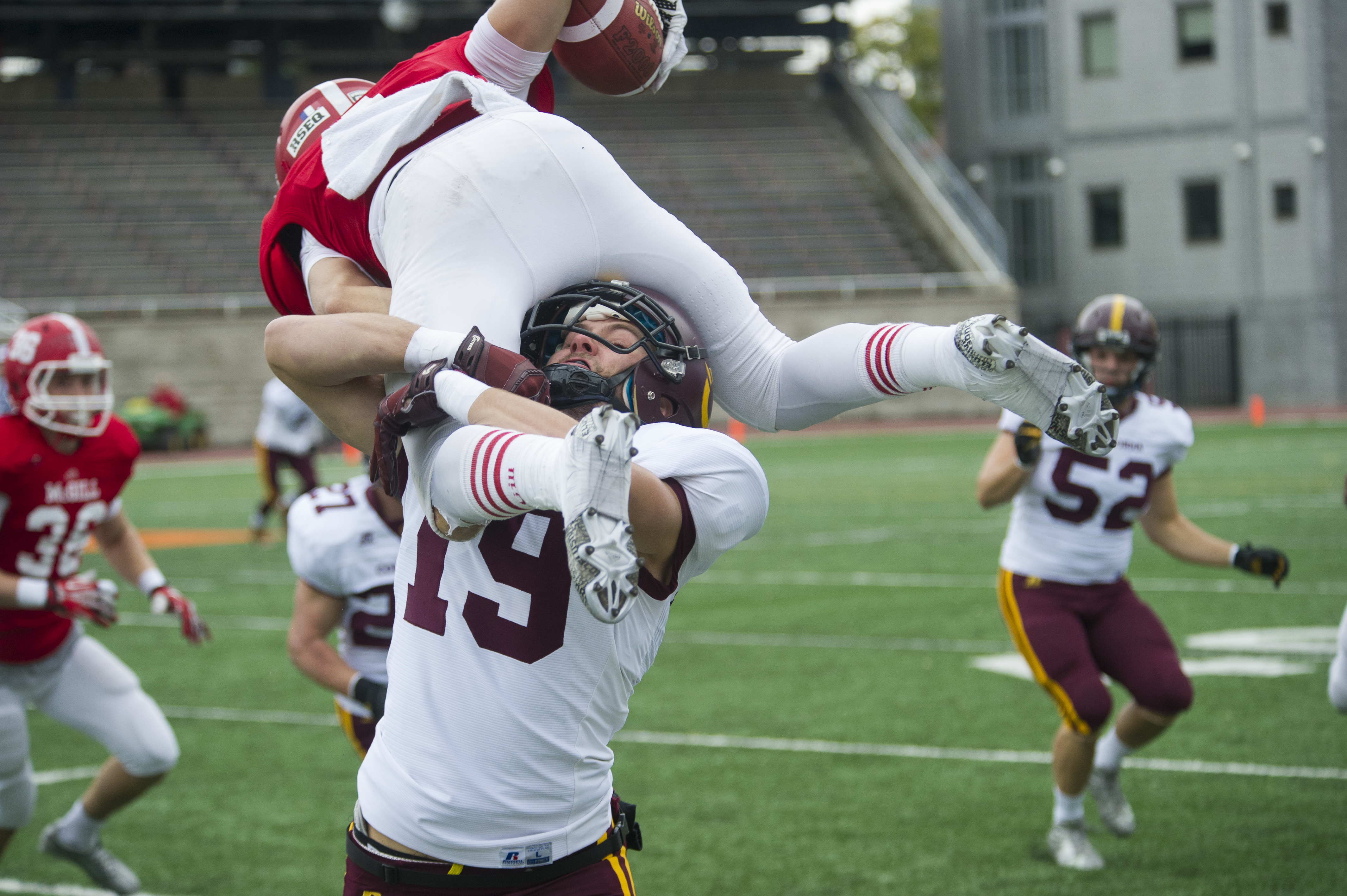 Halfback Sean Mayzes tackles a Redman player during Saturday's game. Photo by Andrej Ivanov.