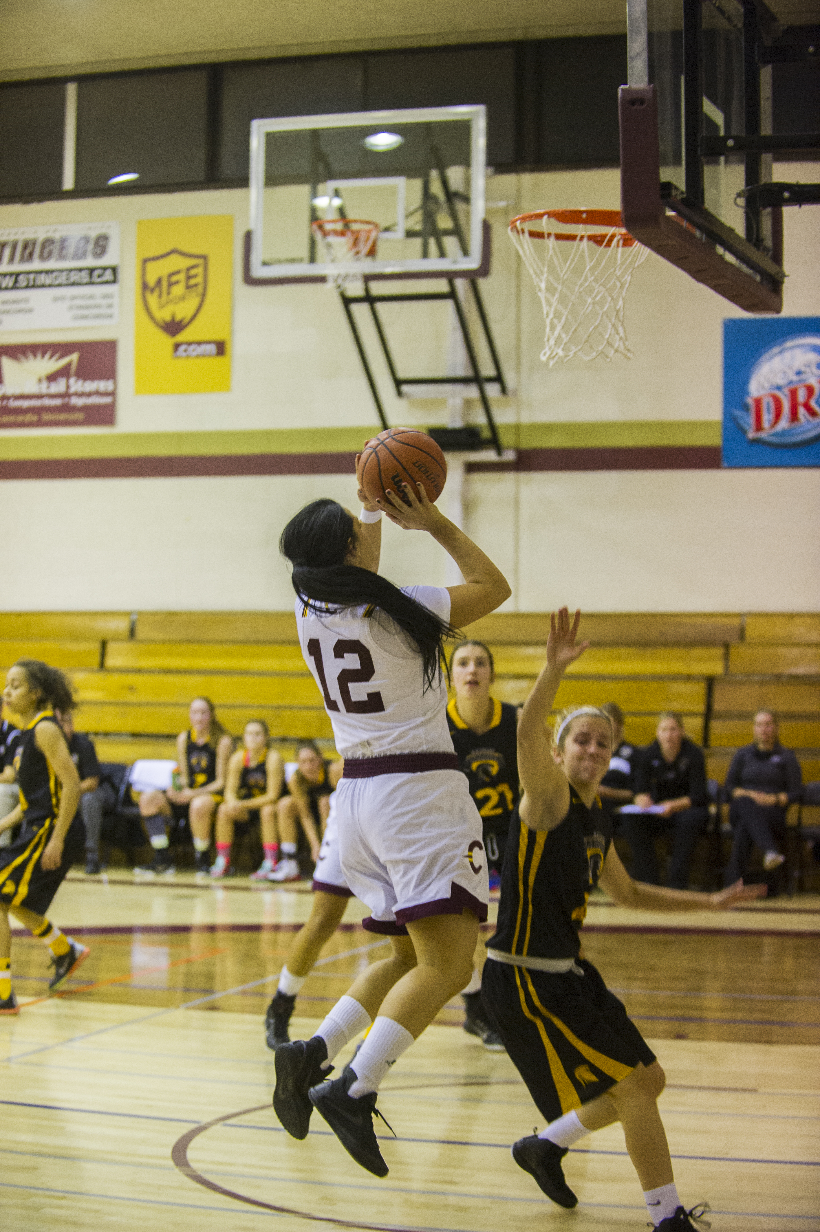 Stingers forward Richelle Grégoire goes up against a Waterloo defender for a basket. Photo by Andrej Ivanov.