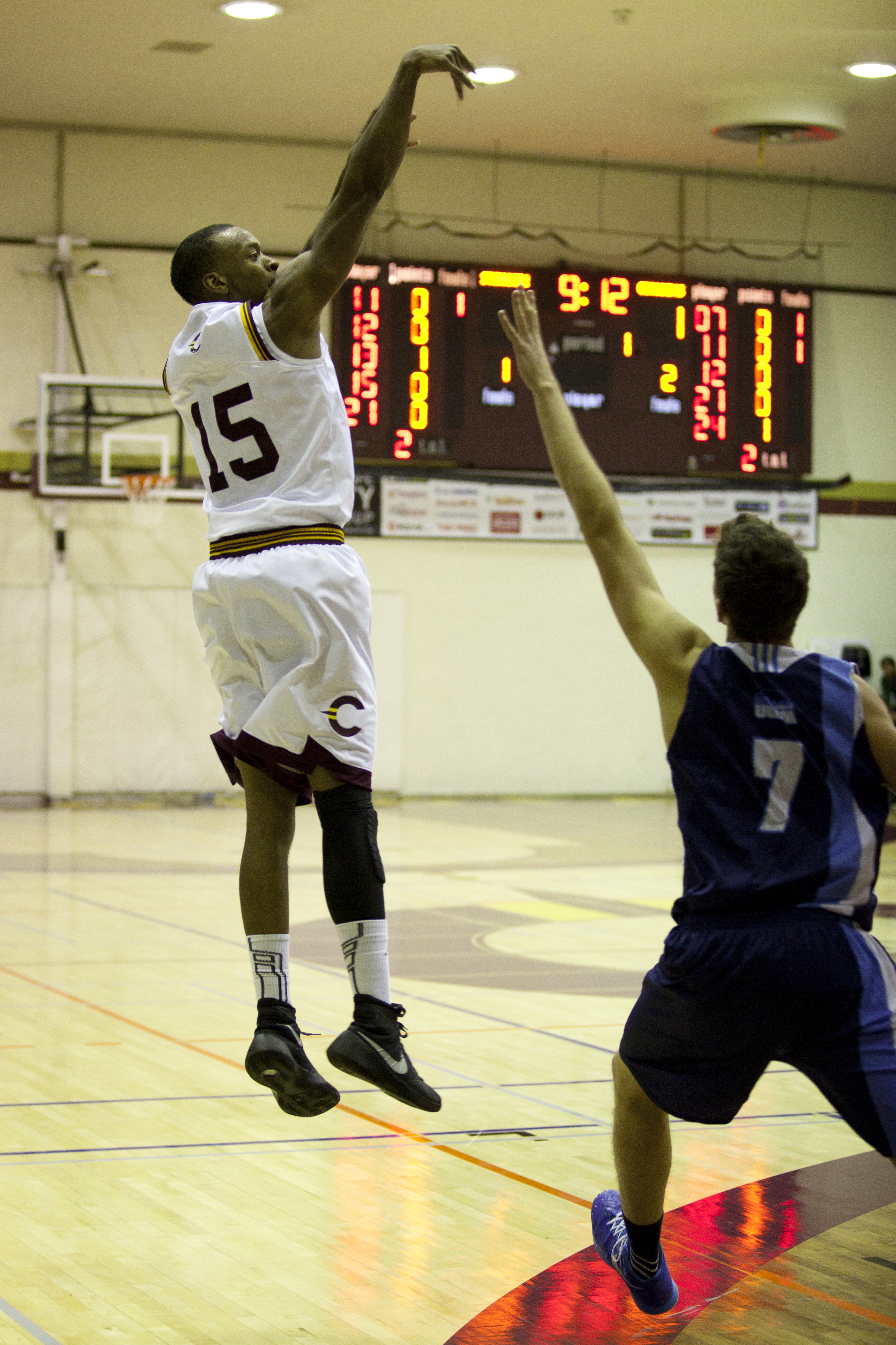 Jaleel Webb in mid-air after a shot. Photo by Marie Pierre Savard.