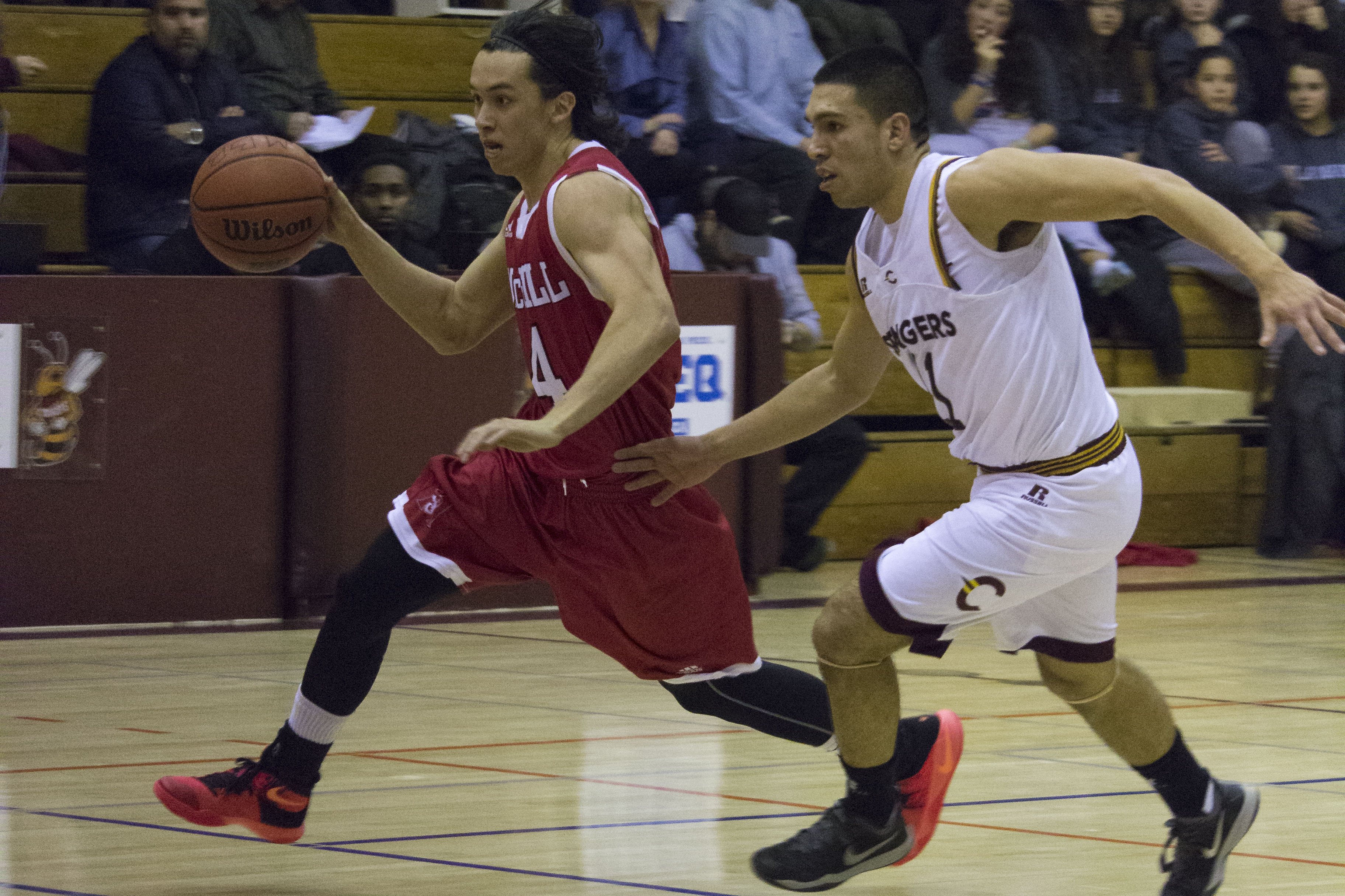 Point Guard Ricardo Monge fights off a Redmen player during their win on Jan. 21. Photo by Kelsey Litwin.