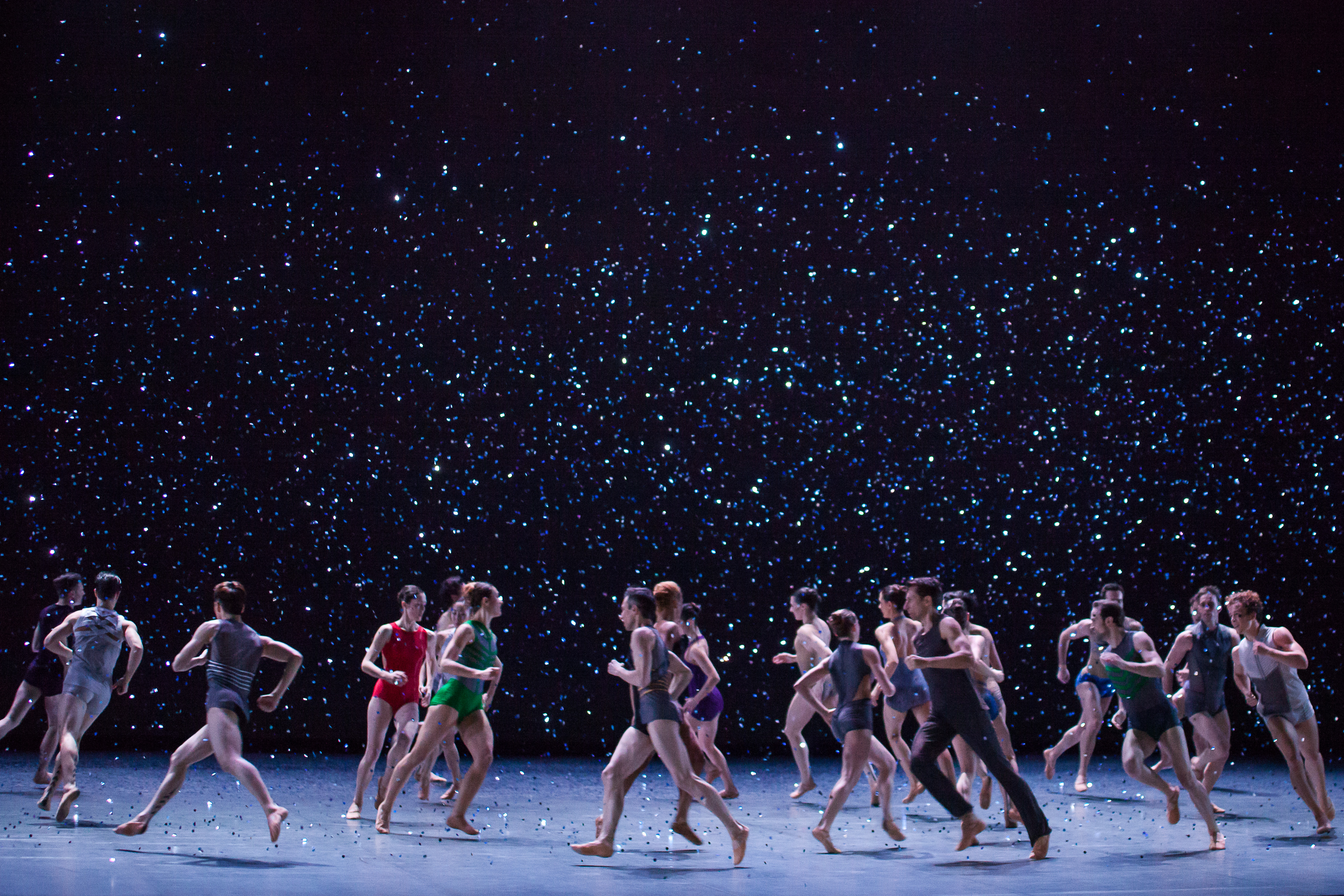 Dim Light of Dawn ends in a shower of blue glitter that intensifies as it falls on the dancers onstage.